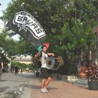 Jonathan Apreising (drums) and Carlos Juarez (flag) head to the 2014 Spurs Championship River Parade on June 30, 2014. Photo by Iris Dimmick.