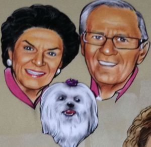 A caricature of Tom Vice, along with his wife, Betty, and dog, Sassy, as seen at the Palm Restaurant. Photo courtesy Felicia Glenn.
