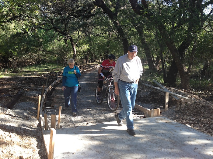 Hikers and cyclists utilizing the popular Salado Creek Greenway even before completion while under construction. Photo by Julia Murphy.