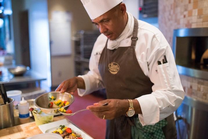 Chef Johnny Fitzhugh prepares a salad at Nao. Photo by Scott Ball.