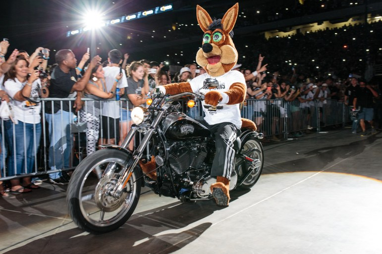 The Coyote rolled in on a custom Spurs motorcycle to the Spurs celebration at the Alamodome of their 2014 NBA Finals victory. Photo by Scott Ball.