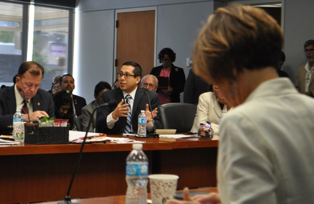 District 1 Councilman Diego Bernal asks CPS Energy Executive Vice President Cris Eugster (not pictured) questions about the proposed grid fee during B Session on June 11, 2014. Photo by Iris Dimmick.