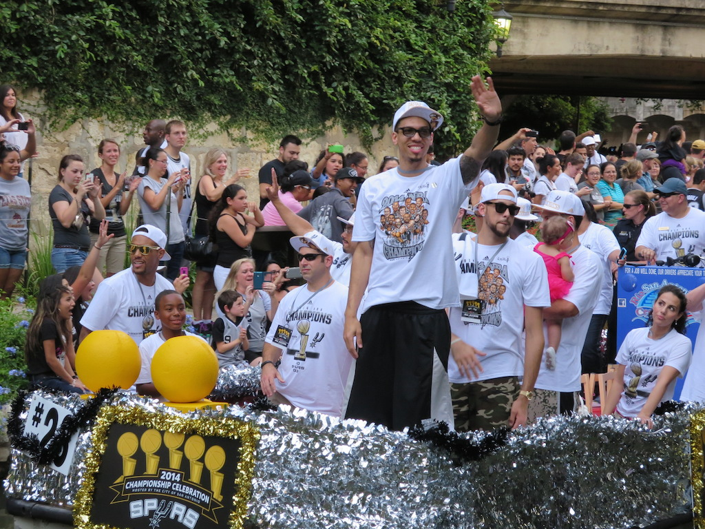 Danny Green waves to fans during the 2014 Spurs Championship River Parade on June 30, 2014. Photo by Garrett Heath.