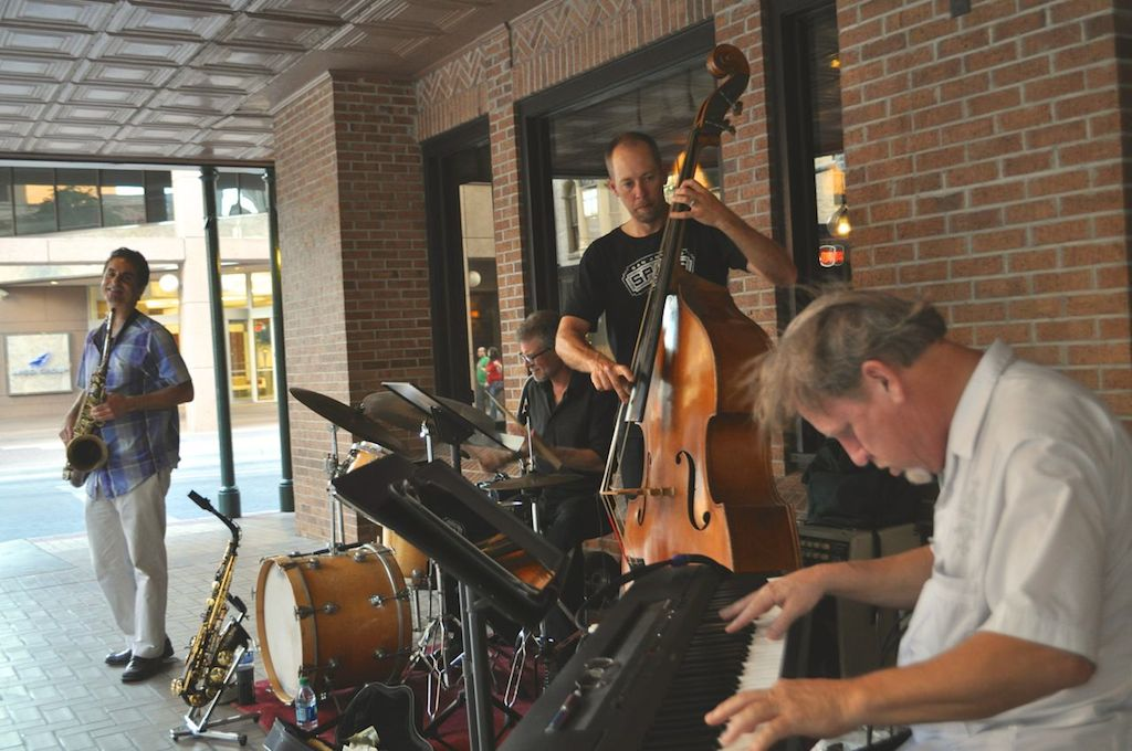 Members of the flagship group South Texas Jazz play on Houston Street while Doc Watkins and his Big Band play on stage at The Empire Theatre. June 10, 2014. Photo by Iris Dimmick.