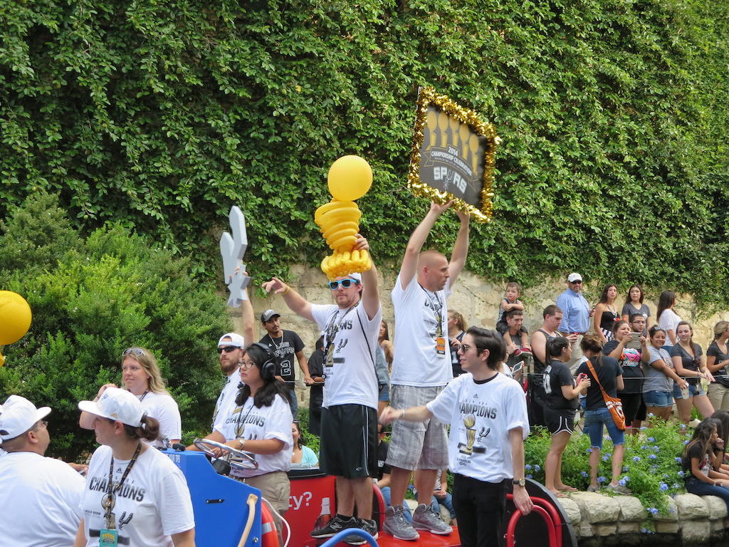 Spurs fans pass by on a river barge during the 2014 Spurs Championship River Parade on June 30, 2014. Photo by Garrett Heath.