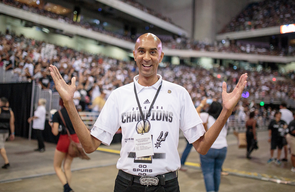 Spurs emcee J.C. Carpenter during the Spurs celebration at the Alamodome of their 2014 NBA Finals victory. Photo by Scott Ball.