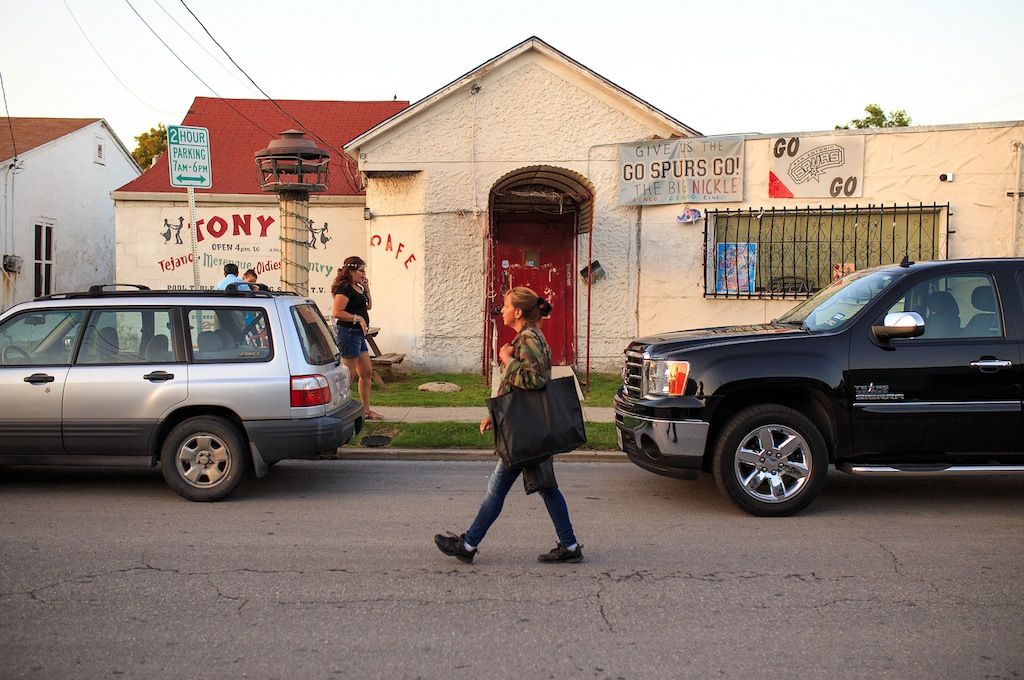 Pedestrians pass by Tony's, which isn't far from the popular Hays Street Bridge, during Game Three of the NBA Finals on June 10, 2014. Photo by Scott Ball.