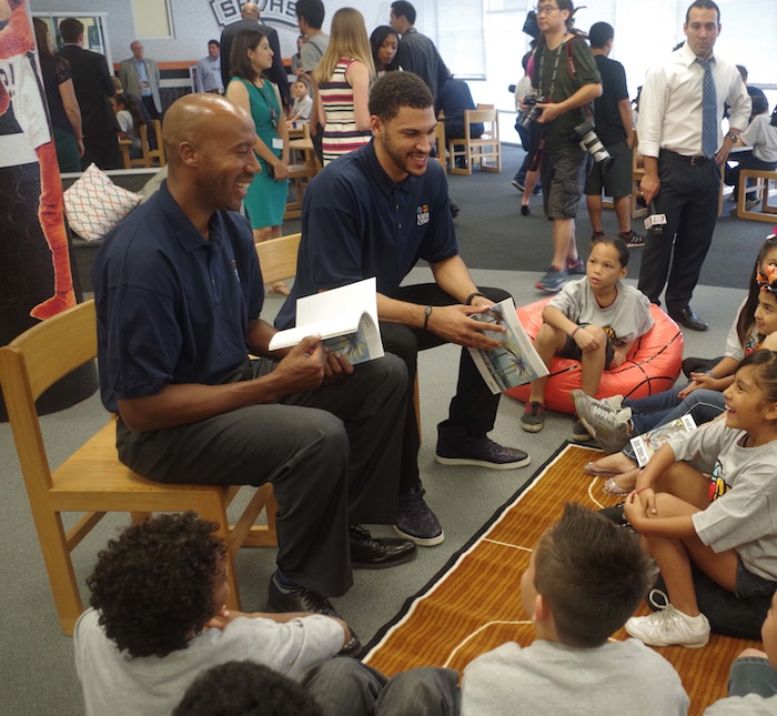 Former Spur Bruce Bowen and current player Jeff Ayres read to Bowden Elementary School students during a press conference announcing a new Spur-sponsored Learn and Play Center at the school on June 6, 2014. Photo by Juan Garcia.