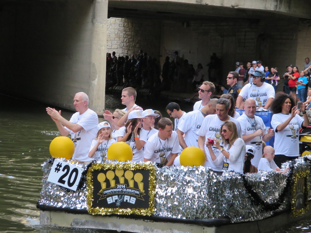 Spurs Coach Gregg Popovich thanks fans during the 2014 Spurs Championship River Parade on June 30, 2014. Photo by Garrett Heath.