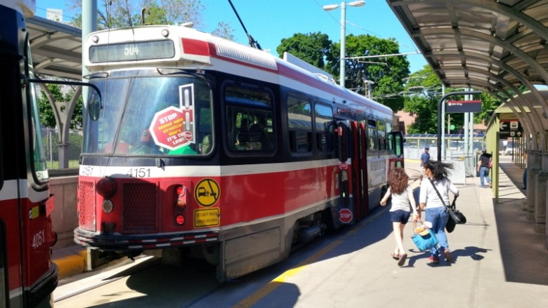 Passengers rush to catch a streetcar at a dedicated stop. Photo by Jessica Martin, courtesy TTC.
