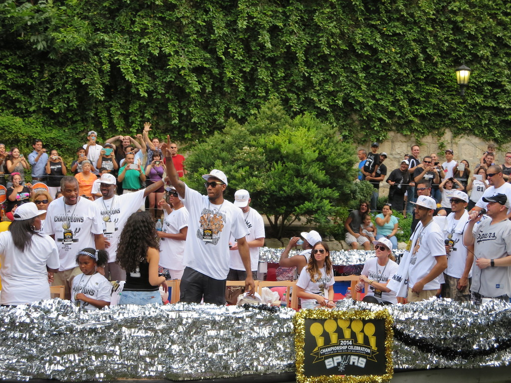 2014 NBA Finals MVP Kawhi Leonard waves to fans during the 2014 Spurs Championship River Parade on June 30, 2014. Photo by Garrett Heath.