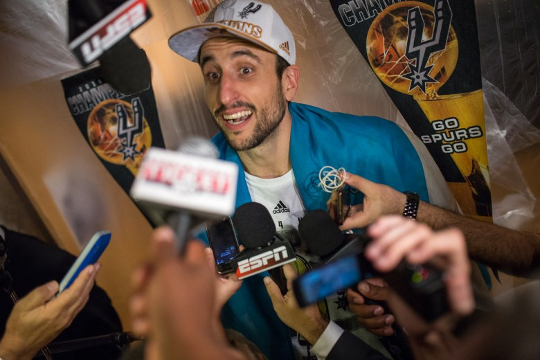 Manu Ginóbili talks with media after Spurs' win of the 2014 NBA Finals. Photo by Scott Ball.