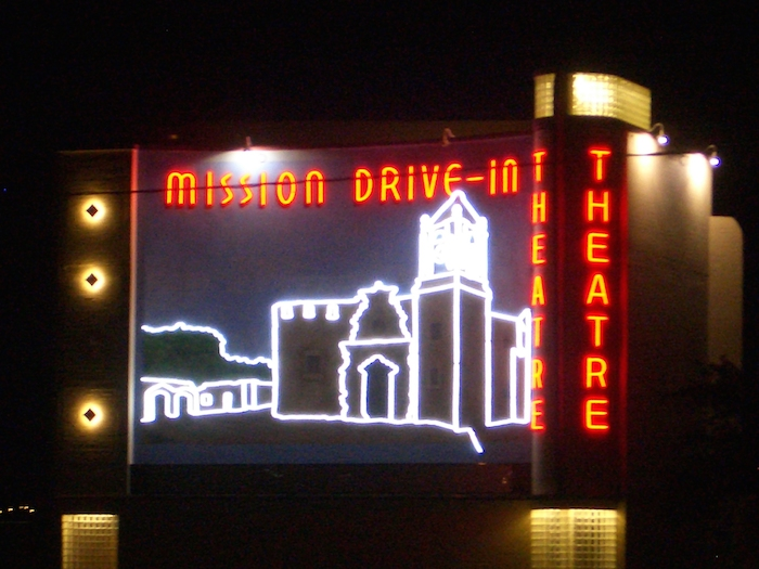Night scene with theater mural outlined in LED lights at the Mission Marquee Plaza grand opening June 7, 2014. Photo by Lily Casura.