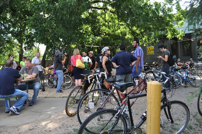 """During the South Flores Street lane removal protest, """"Every Lane is a Bike Lane."""" June 4, 2014. Photo by Iris Dimmick."""
