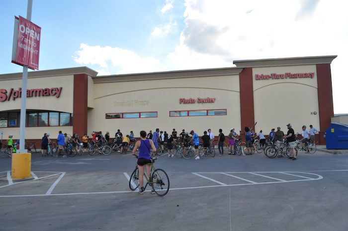 """Cyclists gather in the CVS Pharmacy parking lot at during the South Flores Street lane removal protest, """"Every Lane is a Bike Lane."""" June 4, 2014. Photo by Iris Dimmick."""
