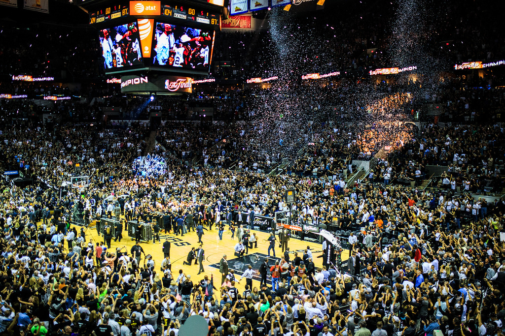 Hundreds of fans and press surround the Spurs as they celebrate their win of the 2014 NBA Finals. Photo by Scott Ball.