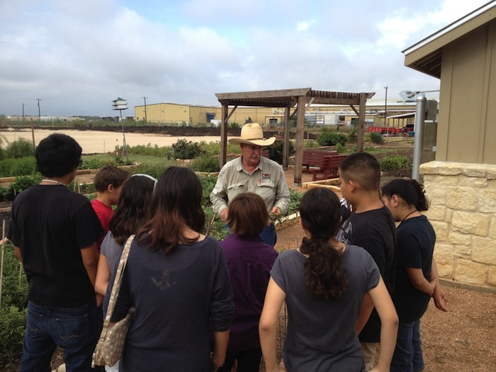 Students take a tour of the Spurs Community Garden. Photo courtesy of Growing Hope.