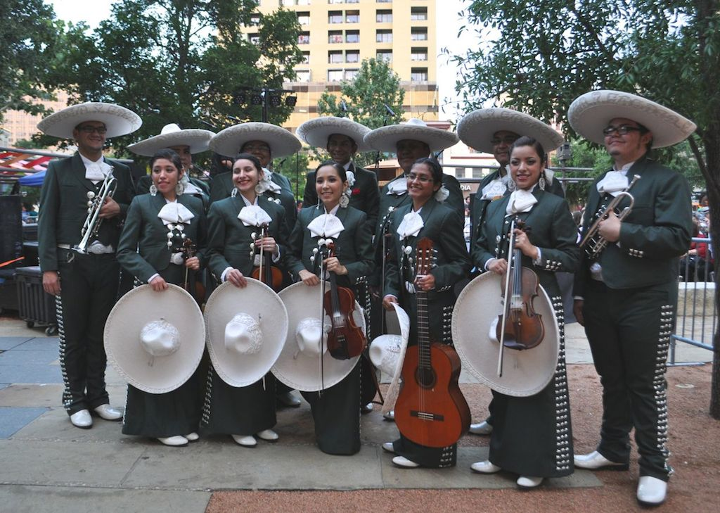 Members of the Mariachi Corazón de San Antonio pose for a photo during the opening night of the art installation in Main Plaza. Photo by Iris Dimmick.