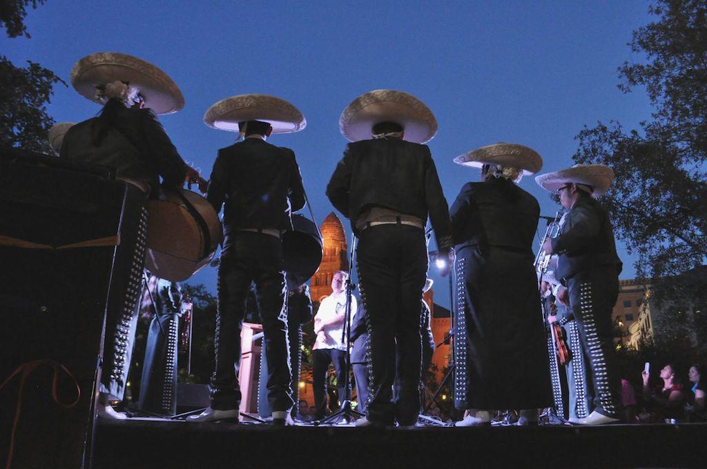 "Mariachi Corazón de San Antonio serenades ""The Saga"" artist Xavier de Richemont for his birthday on opening night of the art installation in Main Plaza. Photo by Iris Dimmick."