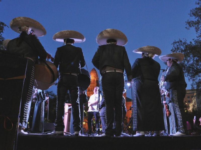 "Mariachi Corazón de San Antonio serenades ""The Saga"" artist Xavier de Richemont for his birthday on opening night of the art installation in Main Plaza. Photo by Iris Dimmick."