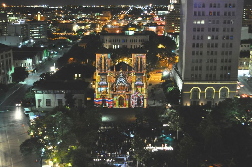"""Downtown San Antonio during the opening night of """"The Saga"""" video art installation on San Fernando Cathedral in Main Plaza. Photo by Iris Dimmick."""