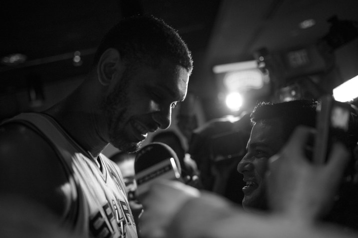 Tim Duncan surrounded by media after the Spurs' win of the 2014 NBA Finals. Photo by Scott Ball.