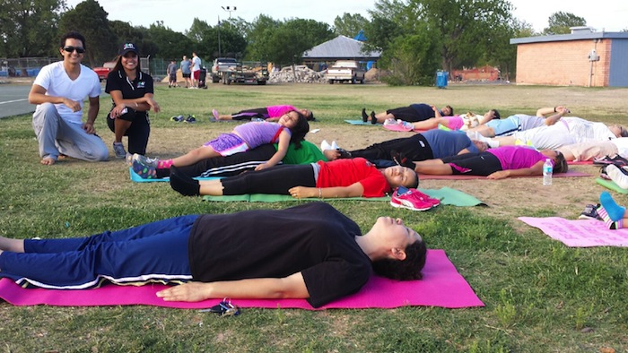 Yoga for the whole family at Woolawn Lake Park during Yoga Day 2013. Courtesy Yoga Day.