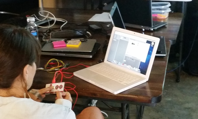 Trying out the Makey-Makey controller at the Open Ed Jam. Photo by Andrew Moore.