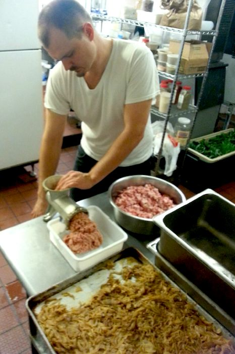 Chef Michael Sohocki grinds fresh local pork with caramelized onions and cooked pig skin to make cotechino, a traditional Italian sausage, for Restaurant Gwendoyln. Photo by Don Thomas.