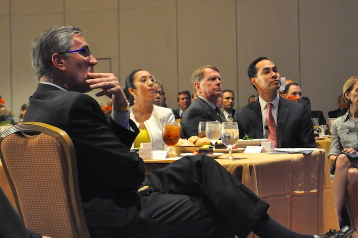 """Centro CEO Pat Digiovanni (front) listens with Mayor Julián Castro and wife Erica to Graham Weston's introduction of the mayor during Centro San Antonio's """"The Future of Downtown"""" luncheon. July 10, 2014.  Photo by Iris Dimmick."""