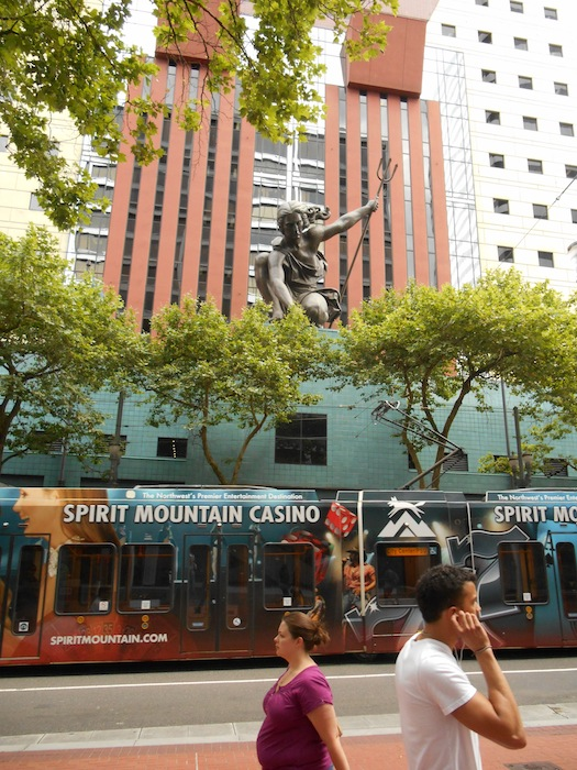 The statue of Portlandia reaches for a streetcar. Photo by Don Mathis.