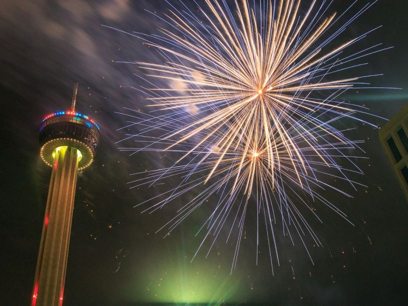 Fireworks explode near the Tower of Americas during the 2014 Fourth of July celebration at Hemisfair Park in San Antonio. Photo by Scott Ball.