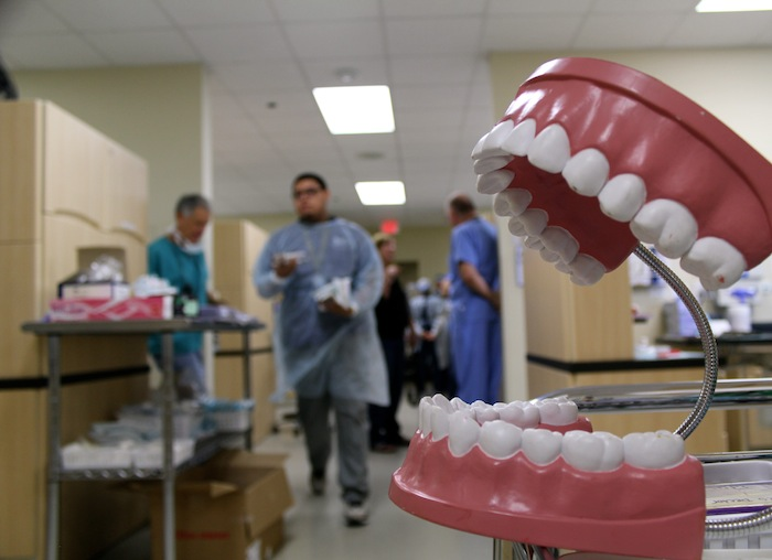 RDA Program graduate Eddie Acosta and two volunteer dentists on their way to see more patients. Photo by Paola Longoria.