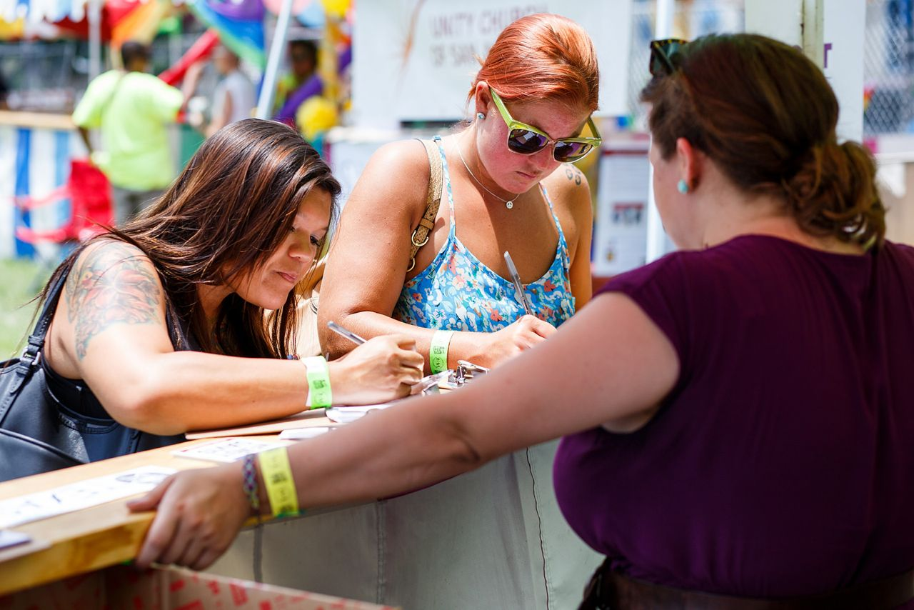 """Melissa Jeffords and Sarah Silk sign their support for Wendy Davis at the 2014 Pride """"Bigger Than Texas"""" Festival. Photo by Scott Ball."""