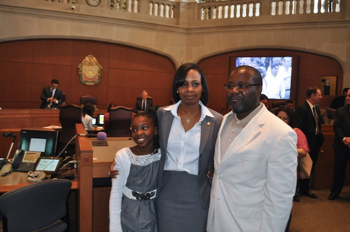 Mayor Ivy Taylor stands with her husband, Rodney Taylor, and daughter, Morgan moments after Ivy was sworn in as mayor. Photo by Iris Dimmick.