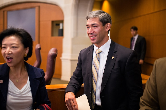 District 8 Councilman Ron Nirenberg and former District 9 Councilwoman Elisa Chan, who was present during the vote, talk with colleagues and fellow citizens before the special meeting. Photo by Scott Ball.
