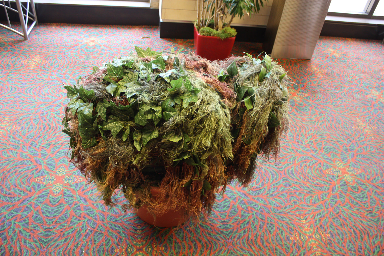 This is not a potted plant, rather it's one of the most deceiving cosplays of this year's San Japan. This trickster appeared in major walkways, moving every few minutes to startle new victims. Photo by Kay Richter.
