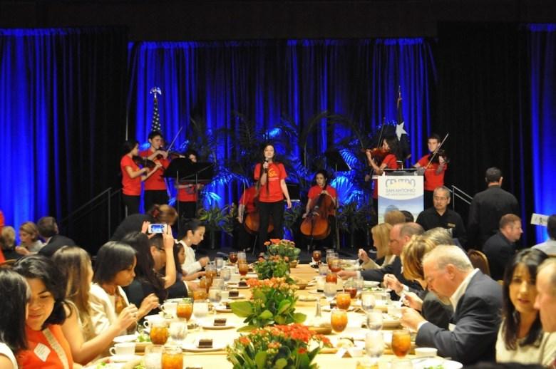 "Youth Orchestra San Antonio members perform on stage during Centro San Antonio's ""The Future of San Antonio"" luncheon, Julián Castro's last, scheduled address as mayor of San Antonio. July 10, 2014.  Photo by Iris Dimmick."