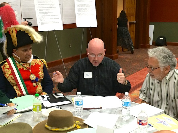 A table of citizens discusses the strengths and weaknesses of Alamo Plaza during a public input workshop. Photo by Katherine Nickas.