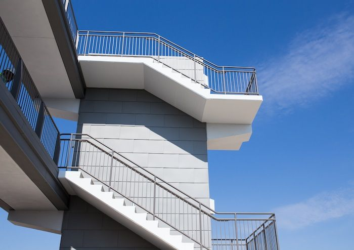 Stairways lead up to the new press box and seats at Alamo Stadium. Photo by Scott Ball.
