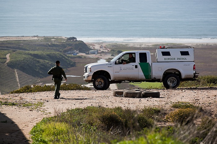 2012: San Diego, CA - U.S. Customs and Border Protection, Border Patrol Agent leaves vehicle to conduct a foot patrol of the area. Photographer: Josh Denmark for the U.S. Customs and Border Patrol.