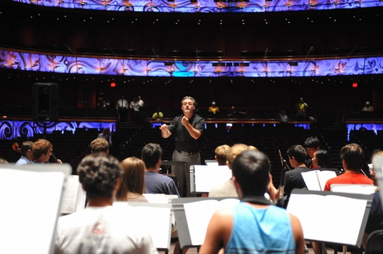 Troy Peters leads YOSA through a pre-performance rehearsal. Photo courtesy Jim Berg/MatsonCreative.