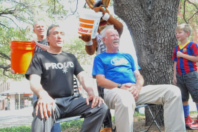 Former Mayors Henry Cisneros (left) and Phil Harberger prepare for the ice bucket challenge. Photo by Iris Dimmick.
