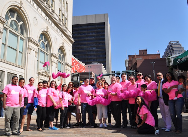 Rideshare advocates pose for a photo outside of City Council chambers. Photo by Iris Dimmick.