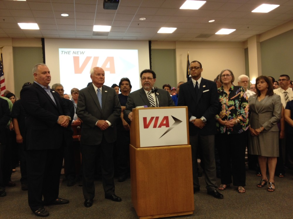 VIA Chairman Alex Briseño, flanked by fellow trustees and staff, addresses media Friday. Photo by Robert Rivard