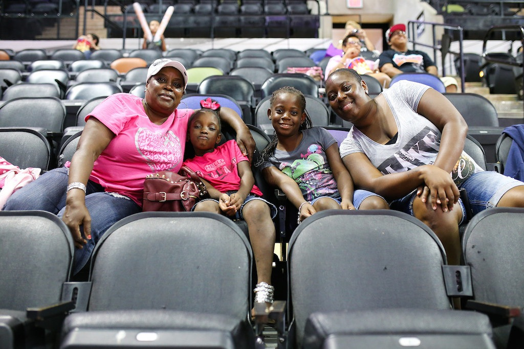 San Antonio Stars fans pose for a photo during a game at the AT&T Center. Photo by Scott Ball.