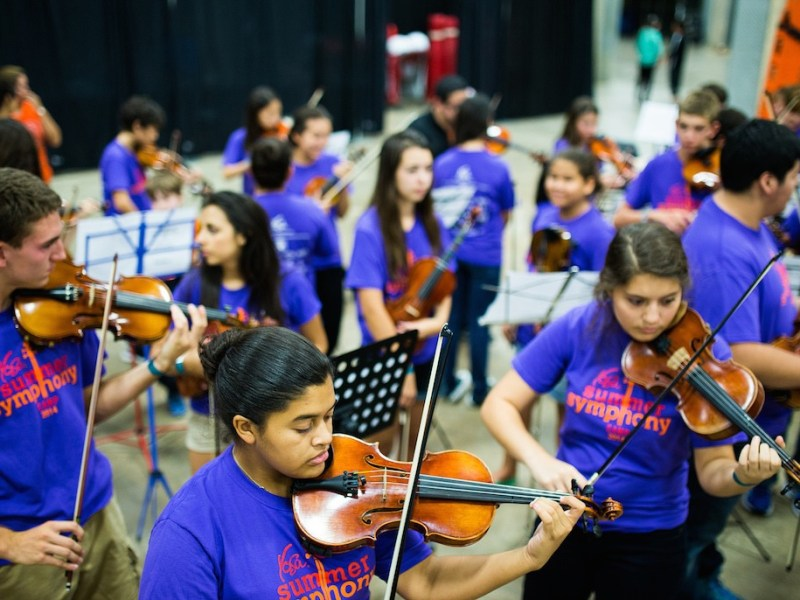 The YOSA Summer Symphony Camp practices before their halftime performance during a San Antonio Stars game. Photo by Scott Ball.