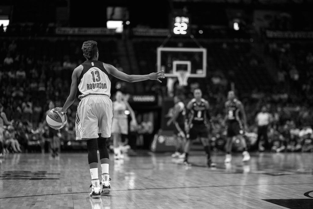 San Antonio Star Danielle Robinson calls a play while taking the ball down court. Photo by Scott Ball.