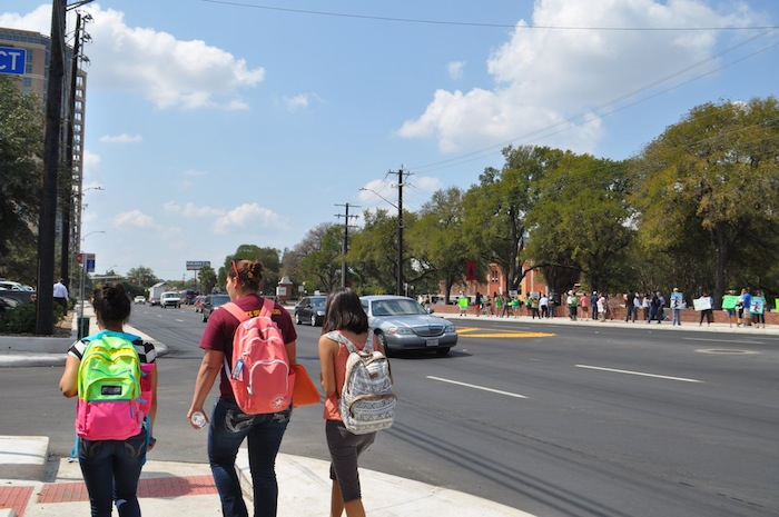 Students walk on Broadway Street while UIW students and parents call for remembrance and justice for Cameron Redus. Photo by Iris Dimmick.