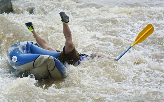 PILAR, NM - A tourist goes over the side on a rapid at Racecourse section of the Rio Grande River near Pilar, New Mexico. JULY 19, 2014: CREDIT: Erich Schlegel/Disappearing Rio Grande Expedition